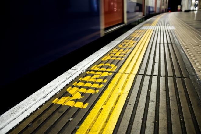 Mind the gap sign on a railway platform